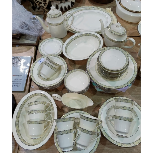 43 - A Minton Wimbledon dinner and tea service approx 60 peices...