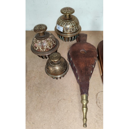45 - Three graduating Middle Eastern elephant claw bells and a set of wood and leather bellows...