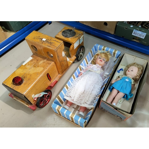 46 - A ride-along toy engine and two 1960's dolls...