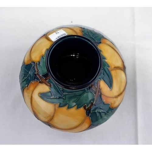 12 - A squat circular Moorcroft vase decorated with apricot type fruit & green leaves impressed diameter ...