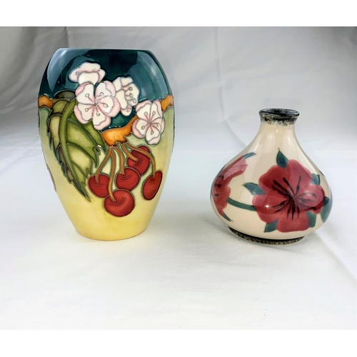 18 - A Moorcroft vase of ovoid form decorated with cherries & white flowers, designed by D.J. Hancock,  i...