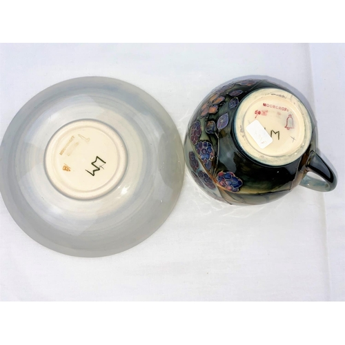 19 - A Moorcroft cup & saucer decorated with brambles (blackberries & leaves) impressed & monogrammed (se...