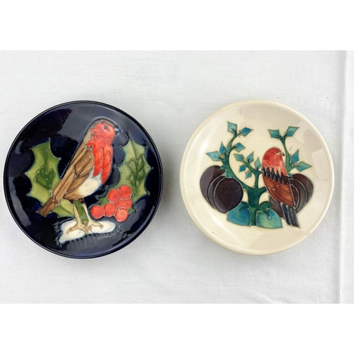 21 - 2 Moorcroft pin dishes one decorated with robin on holly twig, the other with a bird, leaves & plums...