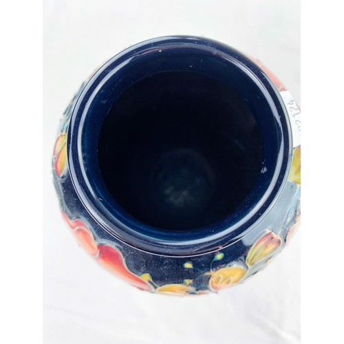 24 - A Moorcroft inverted baluster vase decorated in the Honeysuckle & Dog Rose pattern  impressed & mono...