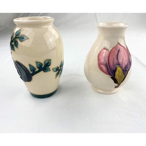 26 - A Moorcroft bird & plum design ovoid vase  impressed & monogrammed height 10cm; a Moorcroft baluster...