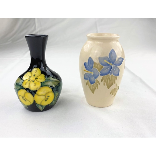28 - A small bulbous slender neck Moorcroft vase decorated with primroses, impressed & monogrammed height...