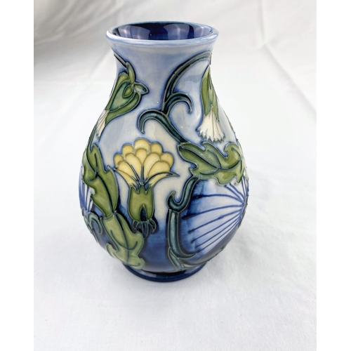 31 - A Moorcroft baluster vase decorated with yellow & white flowers impressed & monogrammed height 13.5c...