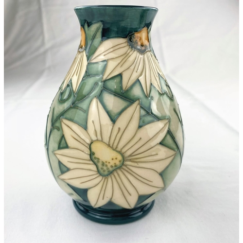 32 - A Moorcroft baluster vase decorated with white star shaped flowers impressed & monogrammed height 13...