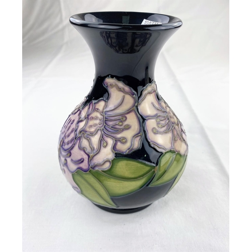 33 - A bulbous Moorcroft vase with flared rim decorated with lilac coloured flowers & green leaves  impre...