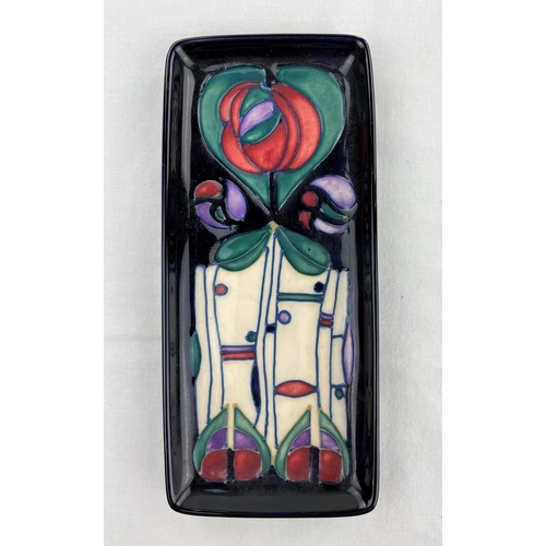 41 - A red Moorcroft pen tray decorated in the Secessionist manner impressed & monogrammed length 20.5cm ...