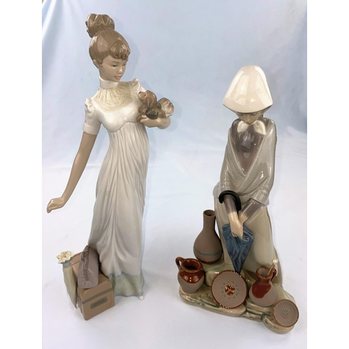 50 - A large Lladro figure: girl with puppy and parasol, height 35cm; a large Lladro figure : girl with u...