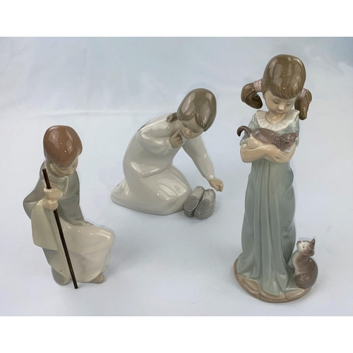 51 - Three Lladro figures, kneeling girl with slippers, girl with kittens & boy with staff