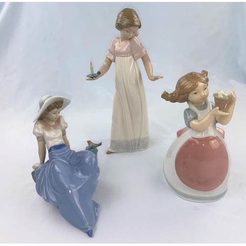 54 - Three Nao figures - girl with candle, girl with pot of flowers, reclining girl with bird