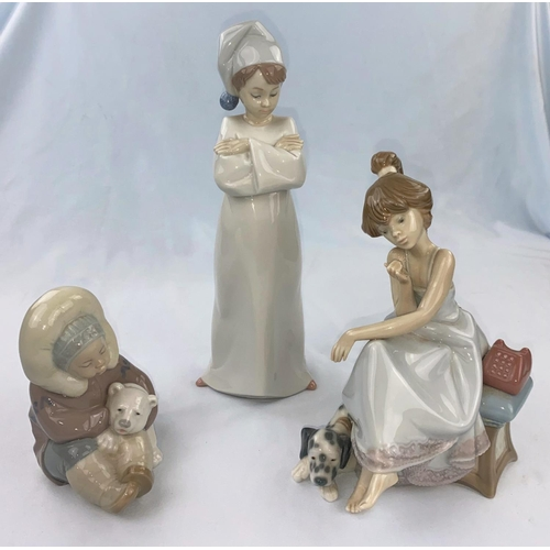 55 - Three Lladro figures - girl in nightcap, Eskimo girl with bear, girl on the telephone (receiver a.f....