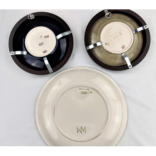 6 - A Moorcroft Magnolia plate diameter 26cm; 2 Moorcroft plates decorated with flower heads diameter 16...