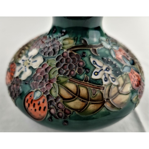 7 - A Moorcroft Carousel vase in squat circular form decorated strawberries & grapes No 823 impressed & ...