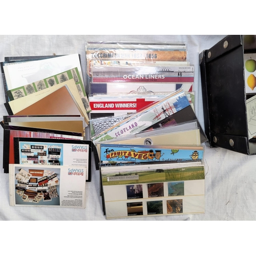785 - GB - a selection of QEII mint commemorative stamps in packets and 12 stamp books
