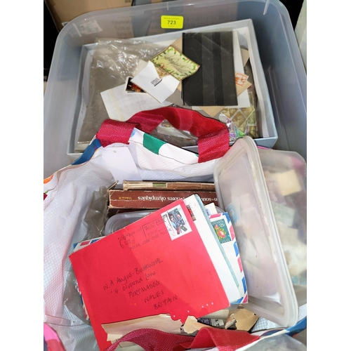 723 - A large quantity of unsorted stamps...