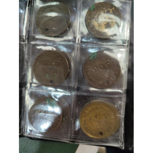 772 - A collection of clocking in tokens from 1890 / 1980
