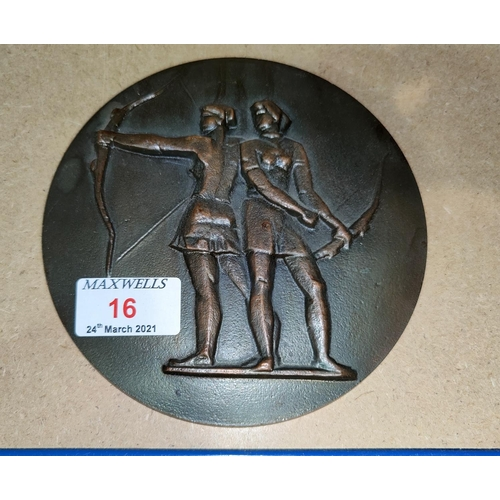 16 - A bronze circular medallion depicting 2 female archers in relief, Moscow Olympics logo on the revers...