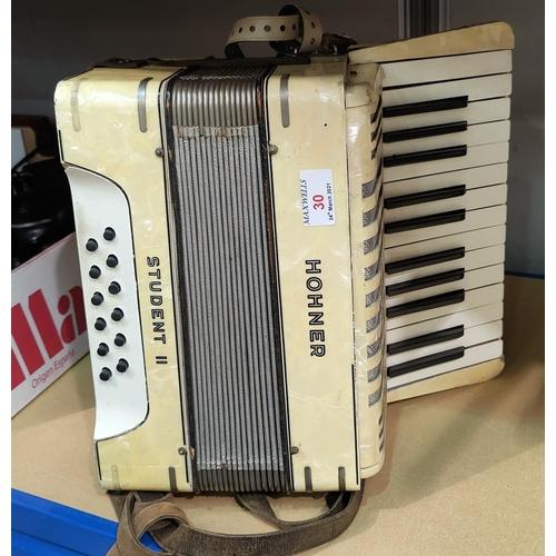 30 - A Hohner 12 base piano accordion