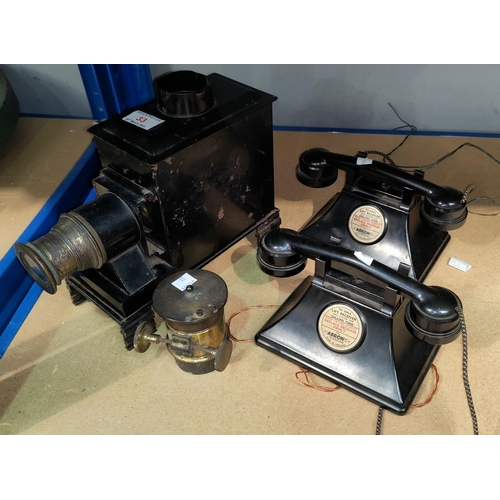 33 - A Victorian magic lantern; 2 Arrow telephones