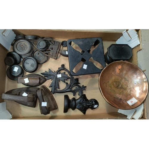 35 - A set of old kitchen scales; various weights; flatirons; etc.