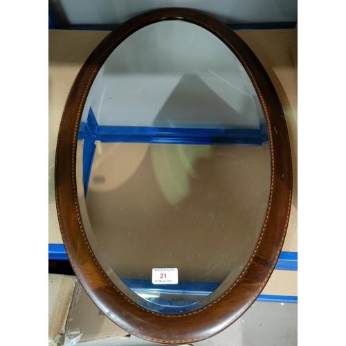 21 - An Edwardian wall mirror in inlaid mahogany oval frame; ornaments; bric-a-brac