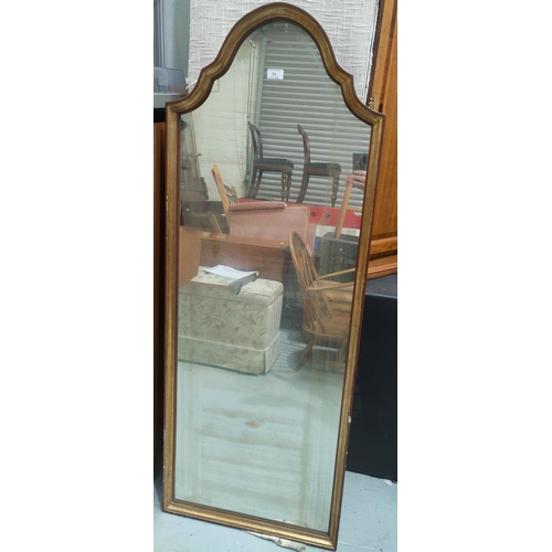 24 - A period style wall mirror in arch top parcel gilt frame; a Persian design rug with blue ground