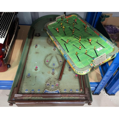 32 - A 1960's tinplate table football game; a bagatelle board