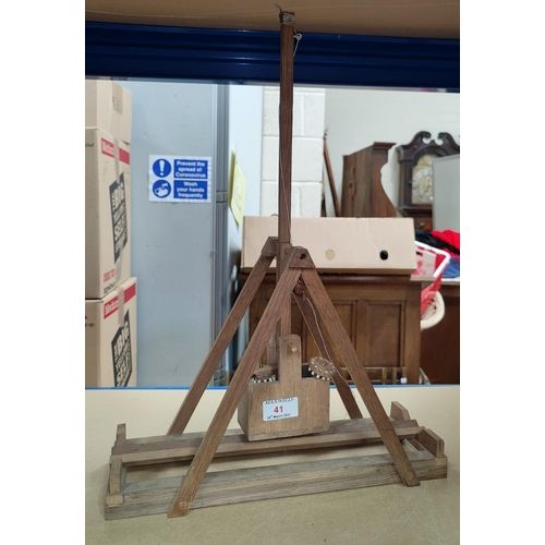 41 - A wooden scratch built model of a trebuchet, length 36 cm (requires restoration) NO BIDS SOLD WITH N...