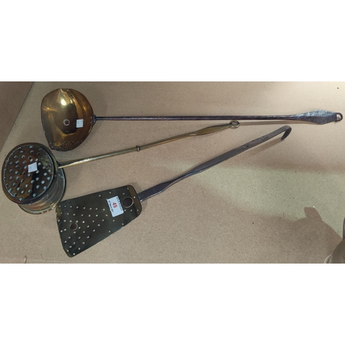 49 - A 19th century cream skimming ladle in brass and wrought iron; a similar slice; an oval chestnut roa...