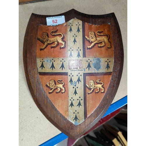 52 - A hand painted shield with Cambridge University coat of arms:  gules on cross ermine between 4 lions...