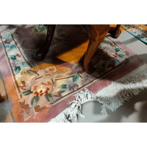 18 - A Chinese rug with floral pattern on a pink ground