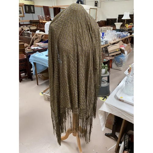 35 - Two embroidered fringed black shawls in the Madeira style; 3 other shawls (some damage / holes0...
