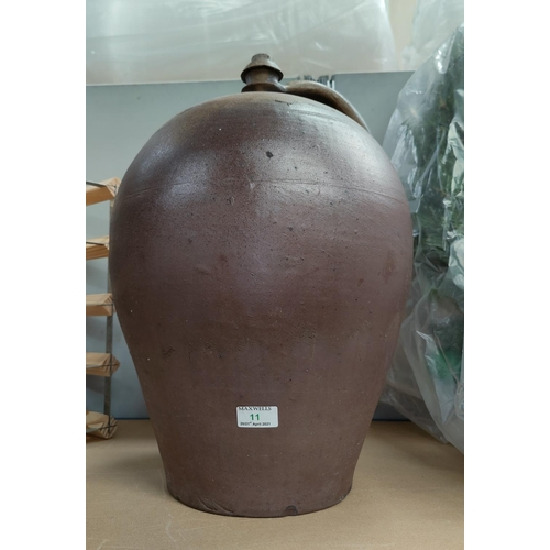 11 - A large stoneware wine flagon ht...