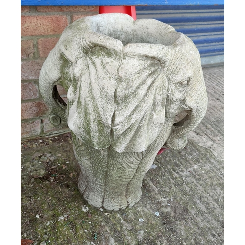 16 - A reconstituted stone garden urn in the form of an elephant's head...