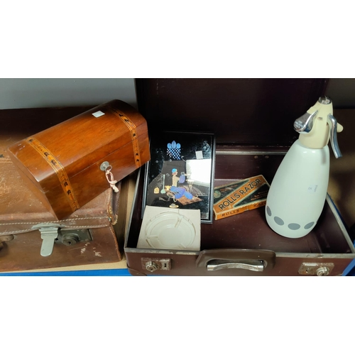 25 - An old leather suitcase; a smaller suitcase; a 19th century walnut and Tunbridgeware tea caddy; a 19...