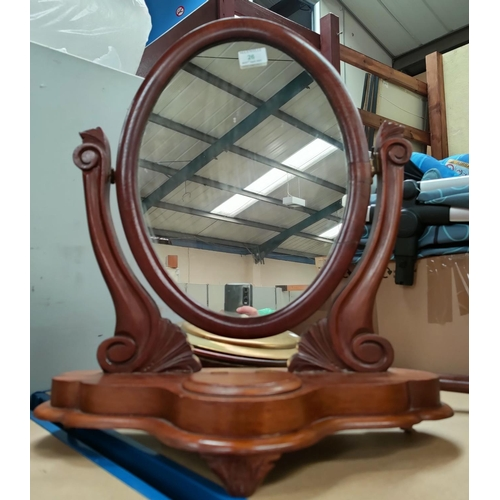 26 - A Victorian oval dressing table mirror in free standing frame (1 hinge replaced); a wall mirror in f...