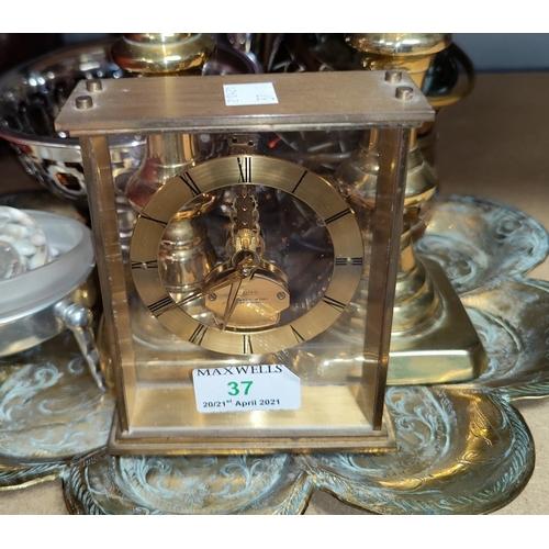 37 - A mid 20th century 'Uwestra' unusual skeleton/mantel clock in gilt metal; decorative brassware; etc....