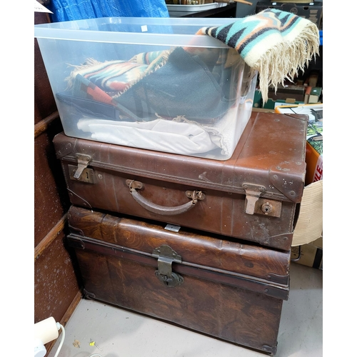 1 - A Victorian tin trunk, a Vulcanide fibre suitcase, a selection of 1930's hand woven wool fabric piec...