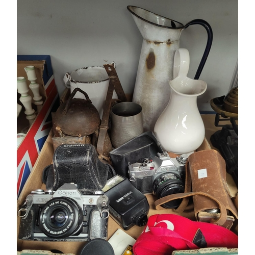 10 - A hand operated sewing machine by Singer; a set of kitchen scales; 3 vintage cameras; cowbells; etc....