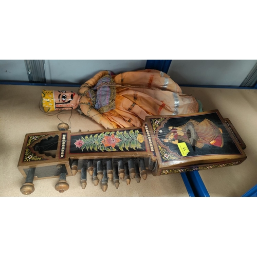 11 - A sitar, painted ad lacquered; an oriental doll...