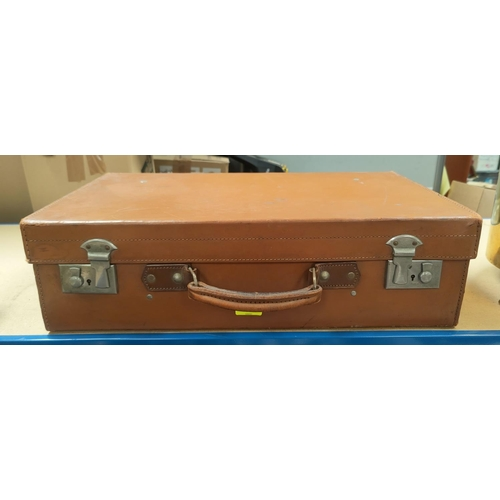 16 - A brown leather suitcase; a pair of binoculars; a cased balance scale; etc....