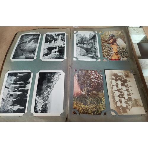 187 - An Edwardian postcard album containing over 250 cards...