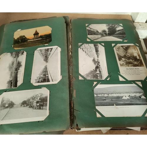 188 - An Edwardian postcard album containing 140+ cards...