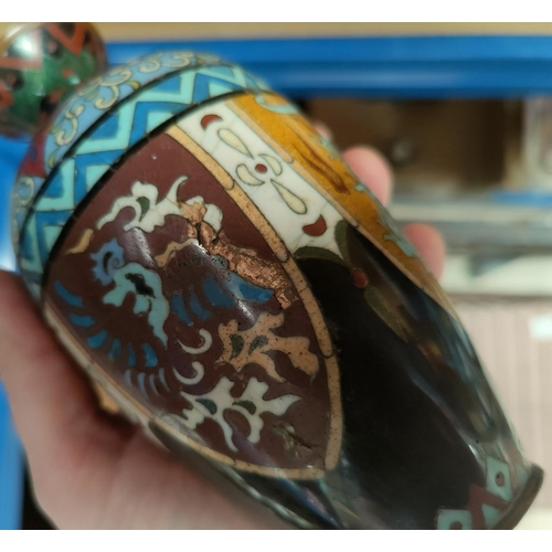 22 - A Chinese pair of cloisonné vases, height 19 cm; a Voigtlander pre-war folding camera; a carved hard...
