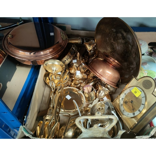26 - A brass table lamp; a reproduction clock; ornamental brassware...