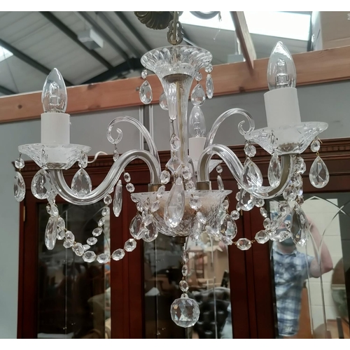 29 - An antique crystal chandelier of 3 branches...