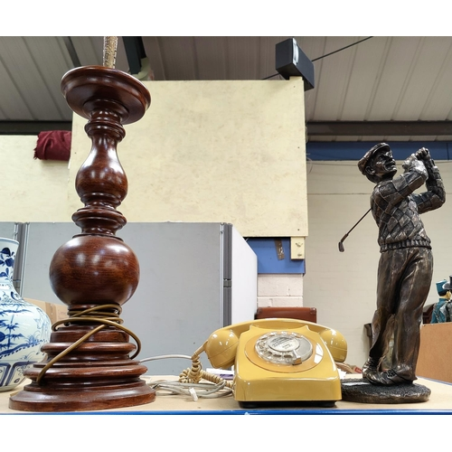 22 - A large bronzed resin figure of a golfer in swing; a large turned wood lamp; a vintage telephone...